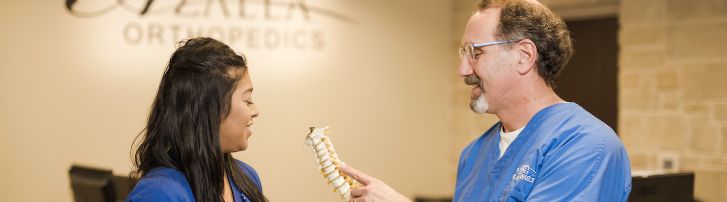Orthopedic spine specialists discussing a patient treatment at Azalea Orthopedics.